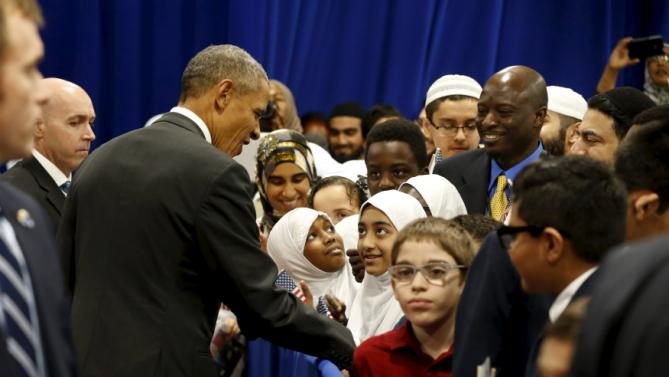 U.S. President Barack Obama greets students after his remarks at the Islamic Society of Baltimore mosque in Catonsville, Maryland February 3, 2016. REUTERS/Jonathan Ernst