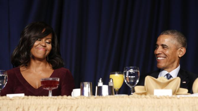 U.S. President Barack Obama and First lady Michelle Obama smile as they attend the National Prayer Breakfast in Washington February 4, 2016. REUTERS/Kevin Lamarque