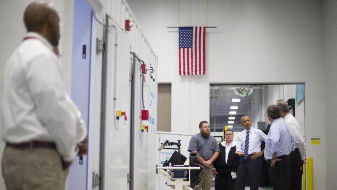 President Barack Obama stops to look over a battery array during his tour of Saft America factory in Jacksonville, Fla., Friday, Feb. 26, 2016. The plant opened in 2011 with help from federal money from economic stimulus package Obama pushed through Congress in 2009. (AP Photo/Pablo Martinez Monsivais)