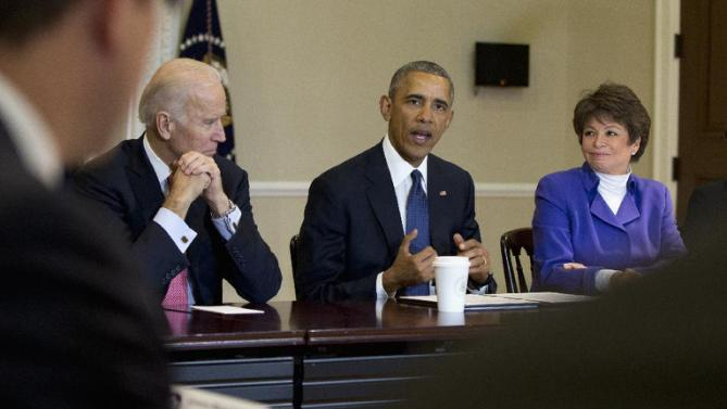 President Barack Obama, joined by Vice President Joe Biden, left, and Senior White House Adviser Valerie Jarrett speaks during a Democratic Governors Association Meeting in the Eisenhower Executive Office Building on the White House campus in Washington, Friday, Feb. 19, 2016. (AP Photo/Carolyn Kaster)