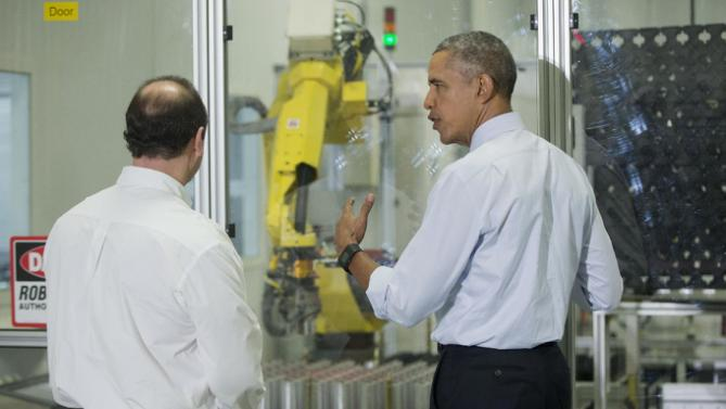 President Barack Obama talks with employee Jim Mastronardi as they watch a robotic demonstration during a tour at Saft America factory in Jacksonville, Fla., Friday, Feb. 26, 2016. The plant opened in 2011 with help from federal money from economic stimulus package Obama pushed through Congress in 2009. (AP Photo/Pablo Martinez Monsivais)