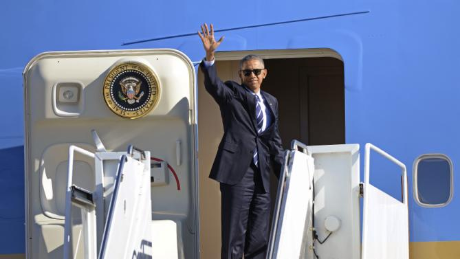 President Barack Obama stops to wave before he enters Air Force One before departing Cecil Airport in Jacksonville, Fla., Friday, Feb. 26, 2016. (AP Photo/Rick Wilson)