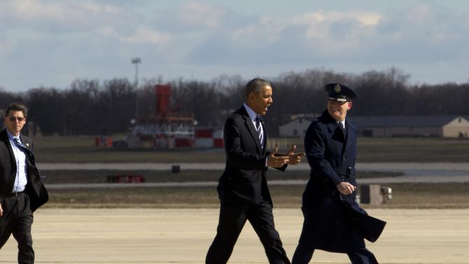 President Barack Obama, accompanied by Col. Lawrence Havird, 89th Maintenance Group commander walks towards Air Force One before departure from Andrews Air Force Base, Md., Friday, Feb. 26, 2016, en route to Jacksonville, Fla., to visit Saft America factory, which opened in 2011 with help from federal money from economic stimulus package he pushed through Congress in 2009.( AP Photo/Jose Luis Magana)