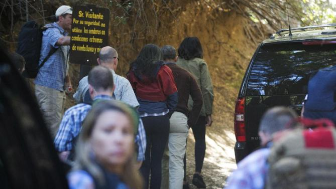 President Barack Obama, center, first lady Michelle Obama, and daughter Malia begin to walk the Villa Tacul Trail of Parque Llao Llao which is part of the Parque Nacional Nahuel Haupi in Bariloche, Argentina, Thursday, March 24, 2016. The first family is spending the remainder of the afternoon in Bariloche, a picturesque city in southern Argentina, before departing for Washington.(AP Photo/Pablo Martinez Monsivais)