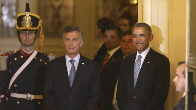 U.S. President Barack Obama stands next to Argentine President Mauricio Macri, center, during a joint news conference at the Casa Rosada Presidential Palace in Buenos Aires, Argentina, Wednesday, March 23, 2016. Obama is on a two day official visit to Argentina. (David Fernandez/Pool Photo via AP)