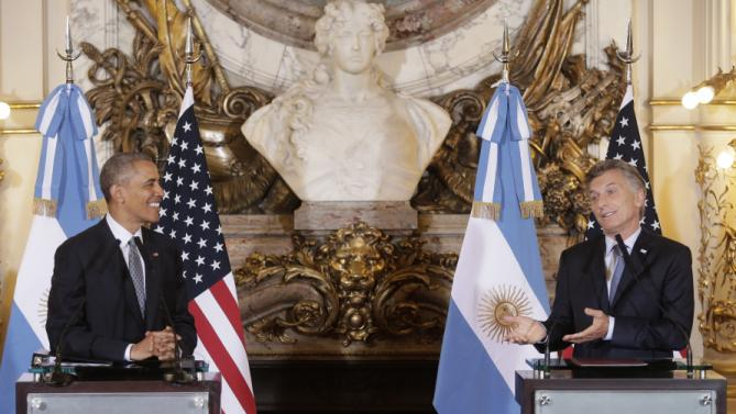 U.S. President Barack Obama shares a light moment with Argentine President Mauricio Macri during a joint news conference at the Casa Rosada Presidential Palace in Buenos Aires, Argentina, Wednesday, March 23, 2016. Obama is on a two day official visit to Argentina. (AP Photo/Victor R. Caivano)