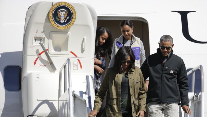 President Barack Obama accompanied by first lady Michelle and daughters Sasha, back right, and Malia arrive to Bariloche, Argentina, Thursday, March 24, 2016. Obama is closing his two-day visit to Argentina by spending the afternoon with his family in Bariloche, a picturesque city in southern Argentina, before departing for Washington. (AP Photo/Natacha Pisarenko)