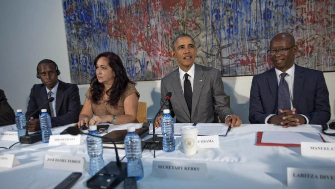 President Barack Obama meets with dissidents and other local Cubans at the U.S. Embassy, Tuesday, March 22, 2016, in Havana, Cuba. Sitting with Obama, from left are, Nelson Matute, Miriam Celeya, and Manuel Cuesta. (AP Photo/Pablo Martinez Monsivais)