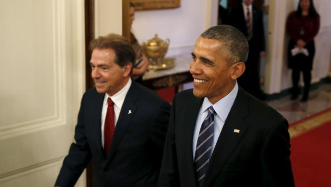 U.S. President Barack Obama (R) escorts University of Alabama football head coach Nick Saban (L) to an East Room ceremony celebrating the team's 2015 college football championship at the White House March 2, 2016. REUTERS/Gary Cameron