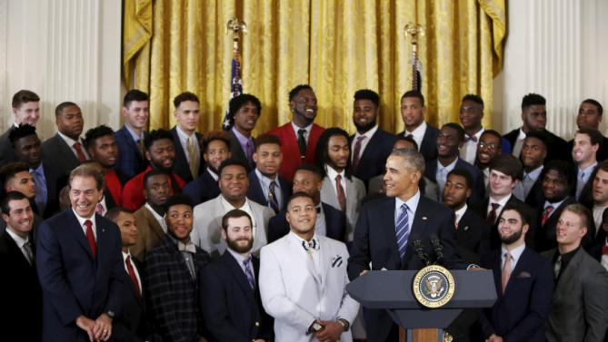 U.S. President Barack Obama greets the 2015 national collegiate football champions, the University of Alabama, with head coach Nick Saban (L) at the White House March 2, 2016. REUTERS/Gary Cameron