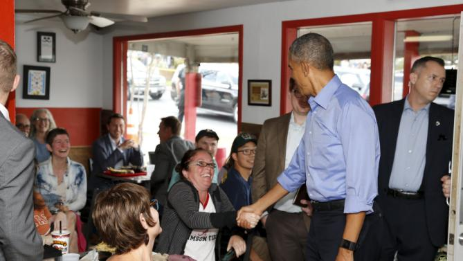 U.S. President Barack Obama greets patrons at Torchy's taco restaurant in Austin, Texas March 11, 2016. Obama is visiting Austin Friday to participate in the South by Southwest Interactive and Democratic Party events. REUTERS/Jonathan Ernst