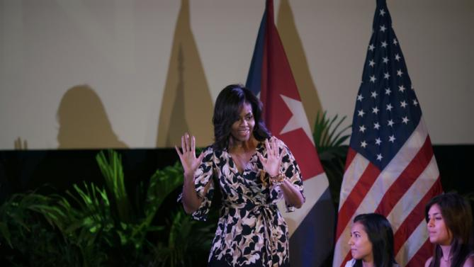 "U.S. first lady Michelle Obama speaks during a ""Let Girls Learn"" conversation with female Cuban students (R) at the Fabrica de Arte Cubano in Havana, Cuba March 21, 2016. REUTERS/Ueslei Marcelino"