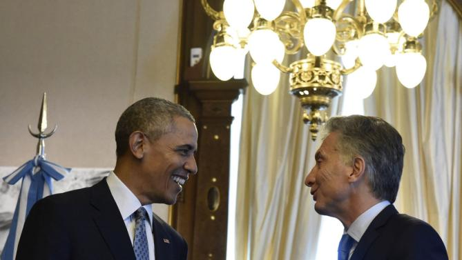 Argentina's President Mauricio Macri (R) and U.S. President Barack Obama talk at the Casa Rosada government house in Buenos Aires in this March 23, 2016 handout photo by the Argentine Presidency. REUTERS/Argentine Presidency/Handout via Reuters ATTENTION EDITORS - THIS PICTURE WAS PROVIDED BY A THIRD PARTY. REUTERS IS UNABLE TO INDEPENDENTLY VERIFY THE AUTHENTICITY, CONTENT, LOCATION OR DATE OF THIS IMAGE. THIS PICTURE IS DISTRIBUTED EXACTLY AS RECEIVED BY REUTERS, AS A SERVICE TO CLIENTS. FOR EDITORIAL USE ONLY. NOT FOR SALE FOR MARKETING OR ADVERTISING CAMPAIGNS.