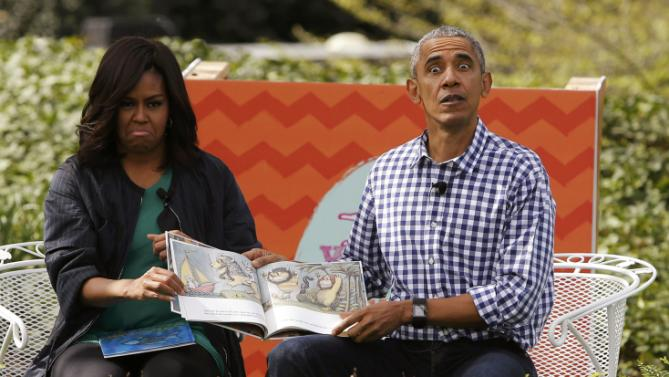 "First lady Michelle Obama and President Barack Obama perform a reading of the children's book ""Where the Wild Things Are"" for children gathered for the annual White House Easter Egg Roll on the South Lawn of the White House in Washington, March 28, 2016. REUTERS/Jonathan Ernst"