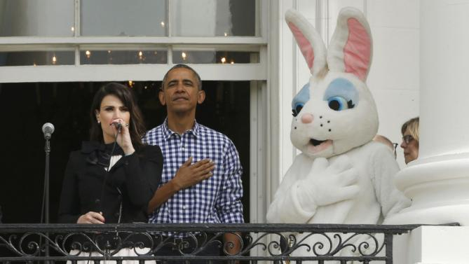 Idina Menzel sings the U.S. National Anthem as President Barack Obama and the Easter Bunny hold their hands over their hearts on the Truman Balcony during the annual White House Easter Egg Roll in Washington, March 28, 2016. REUTERS/Jonathan Ernst