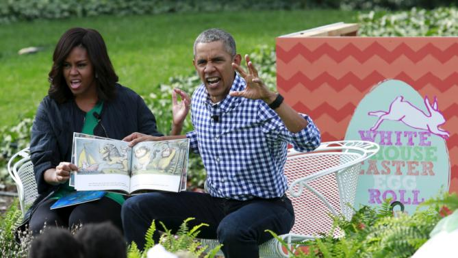 "U.S. President Barack Obama and first lady Michelle Obama perform a reading of the children's book ""Where the Wild Things Are"" for children gathered for the annual White House Easter Egg Roll on the South Lawn of the White House in Washington, March 28, 2016. REUTERS/Yuri Gripas"