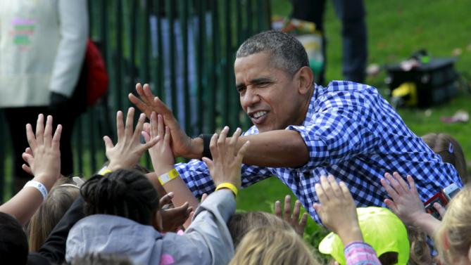 U.S. President Barack Obama greets children gathered for the annual White House Easter Egg Roll on the South Lawn of the White House in Washington, March 28, 2016. REUTERS/Yuri Gripas