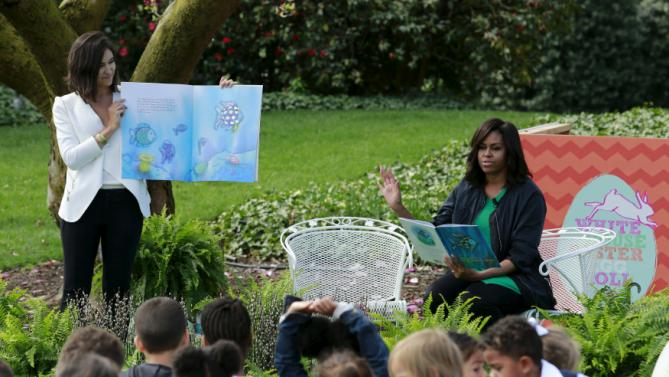 U.S. first lady Michelle Obama reads a children's book during the annual White House Easter Egg Roll on the South Lawn of the White House in Washington, March 28, 2016. REUTERS/Yuri Gripas