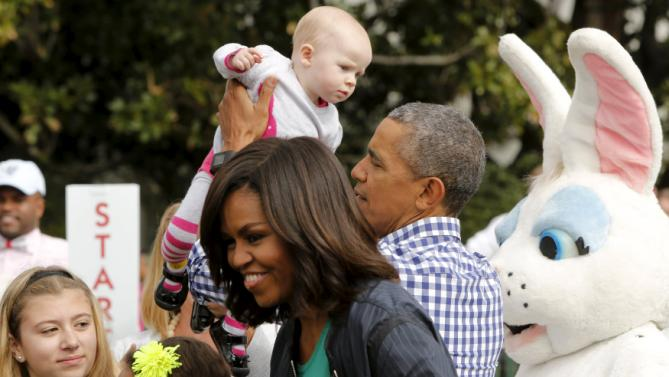 U.S. President Barack Obama (center R) and first lady Michelle Obama (center L) greet children as they preside over the annual Easter Egg Roll at the White House in Washington March 28, 2016. REUTERS/Jonathan Ernst