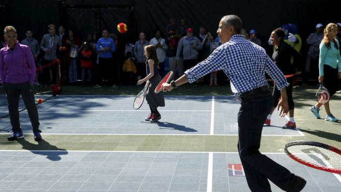 U.S. President Barack Obama plays tennis with children at the annual Easter Egg Roll at the White House in Washington March 28, 2016. REUTERS/Jonathan Ernst