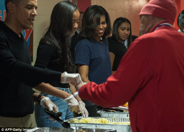 2ED0710900000578-3334139-Michelle_Obama_looks_on_as_her_daughter_Malia_serves-a-14_1448496683739