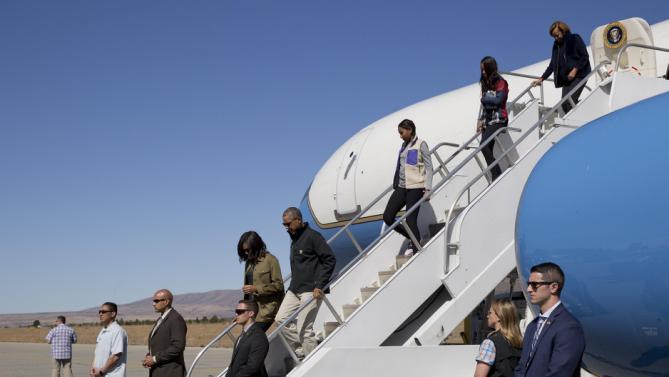 President Barack Obama first lady Michelle Obama, followed by daughters Sasha and Malia and first lady's mother Marian Robinson arrive in San Carlos de Bariloche Airport, Thursday, March 24, 2016 in Bariloche, Argentina (AP Photo/Pablo Martinez Monsivais)