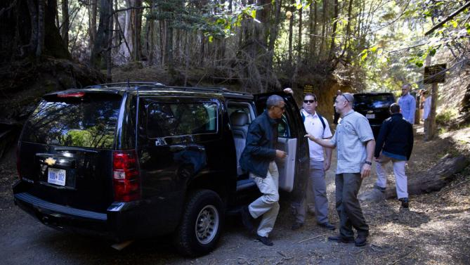 President Barack Obama steps out of his vehicle at Parque Llao Llao which is part of the Parque Nacional Nahuel Haupi in Bariloche, Argentina, Thursday, March 24, 2016. Obama and first family are taking the Villa Tacul Trail and spending the remainder of the afternoon in Bariloche, a picturesque city in southern Argentina, before departing for Washington.(AP Photo/Pablo Martinez Monsivais)