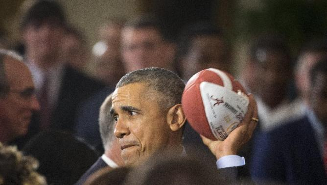 President Barack Obama pretends to throw a football during a ceremony honoring the 2015-2016 College Football Playoff National Champion Alabama Crimson Tide football team, Wednesday, March 2, 2016, in the East Room of the White House in Washington, . (AP Photo/Pablo Martinez Monsivais)