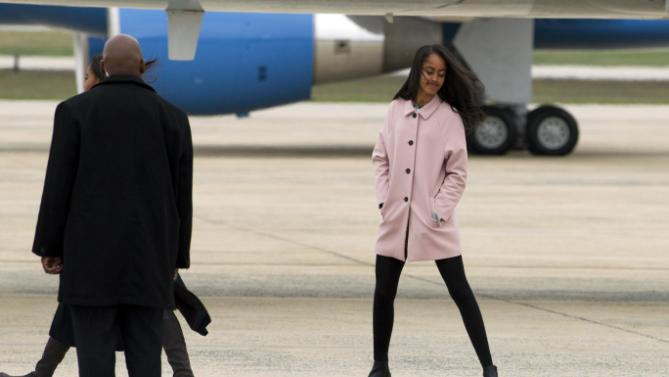 Malia Obama walks towards Air Force One upon the arrival of the first family to Andrews Air Force Base, before their departure, Sunday, March 20, 2016, en route to Havana, Cuba. Obama is the first U.S. president to visit the island in nearly 90 years. ( AP Photo/Jose Luis Magana)