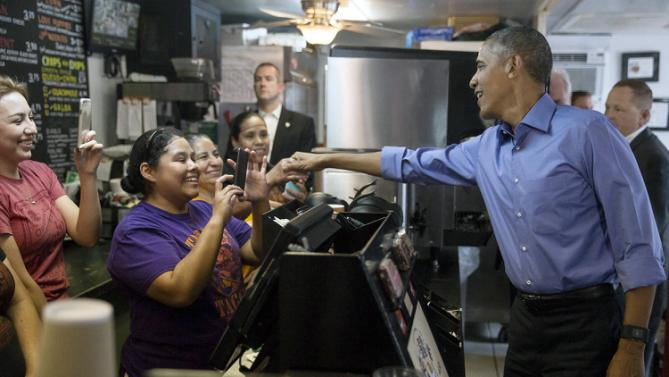 President Barack Obama greeets employees at Torchy's Toco, as the president makes a stop on his way to SXSW Interactive, Friday, March 11, 2016, in Austin, Texas. (Ricardo Brazziell/Austin American-Statesman via AP) AUSTIN CHRONICLE OUT, COMMUNITY IMPACT OUT, INTERNET AND TV MUST CREDIT PHOTOGRAPHER AND STATESMAN.COM, MAGS OUT; MANDATORY CREDIT