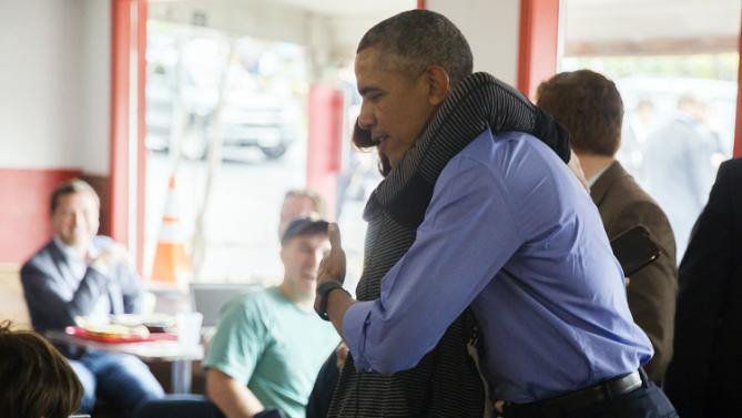 President Barack Obama embraces a customer at Torchy's Toco, as the president makes a stop on his way to SXSW Interactive, Friday, March 11, 2016, in Austin, Texas. (Ricardo Brazziell/Austin American-Statesman via AP) AUSTIN CHRONICLE OUT, COMMUNITY IMPACT OUT, INTERNET AND TV MUST CREDIT PHOTOGRAPHER AND STATESMAN.COM, MAGS OUT; MANDATORY CREDIT