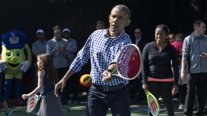 President Barack Obama plays tennis during the White House Easter Egg Roll at the White House in Washington, Monday, March 28, 2016. Thousands of children gathered at the White House for the annual Easter Egg Roll. This year's event features live music, sports courts, cooking stations, storytelling, and Easter egg rolling. (AP Photo/Jacquelyn Martin)