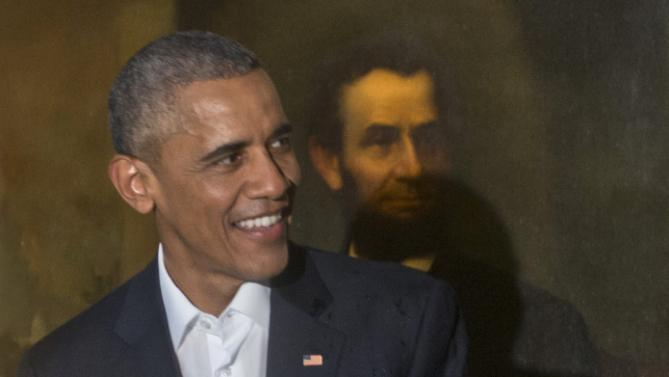 President Barack Obama smiles next to a painting of President Abraham Lincoln at Havana's City Museum during a visit to Old Havana, Cuba, Sunday, March 20, 2016. Obama's trip is a crowning moment in his and Cuban President Raul Castro's ambitious effort to restore normal relations between their countries. (AP Photo/Ramon Espinosa)