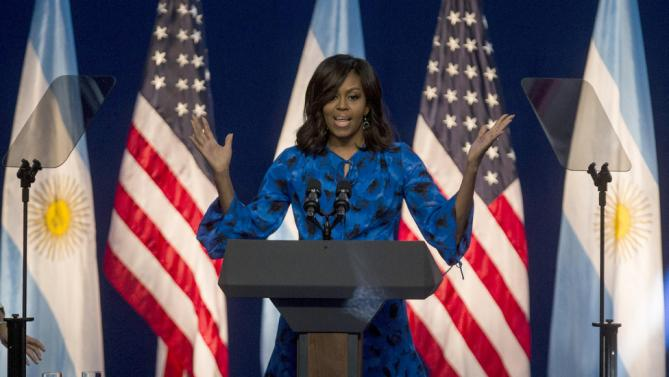 First lady Michelle Obama speaks during a meeting with high school students at the Centro Metropolitano de Diseño, in Buenos Aires, Argentina, Wednesday, March 23, 2016. The First Lady talked about the importance of completing their studies, as part of the Lets girls Learn initiative. (AP Photo/Ivan Fernandez)