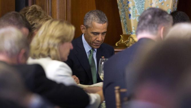 President Barack Obama bows his head during a prayer at a St. Patrick's Day luncheon for Irish Prime Minister Enda Kenny, on Capitol Hill in Washington, Tuesday, March 15, 2016. (AP Photo/Pablo Martinez Monsivais)
