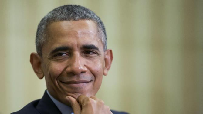 President Barack Obama smiles as he listens to Irish Prime Minister Enda Kenny speak during their meeting in the Oval Office of the White House in Washington, Tuesday, March 15, 2016. (AP Photo/Pablo Martinez Monsivais)