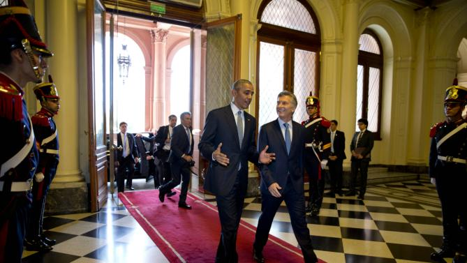 U.S. President Barack Obama and Argentina's President Mauricio Macri walk in the government house in Buenos Aires, Argentina, Wednesday, March 23, 2016. Obama is on a two-day official visit to Argentina. It is the first visit to Argentina by a U.S. president since George W. Bush came here in 2005. (Natacha Pisarenko/Pool Photo via AP)