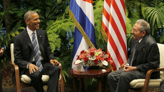Cuban President Raul Castro, right, speaks with U.S. President Barack Obama during a meeting in Revolution Palace, Monday, March 21, 2016. Brushing past profound differences, President Obama and President Castro sat down for a historic meeting, offering critical clues about whether Obama's sharp U-turn in policy will be fully reciprocated. (AP Photo/Ismael Francisco)