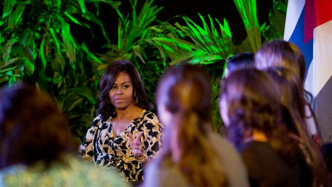 U.S. First Lady Michelle Obama speaks with Cuban girls during a Let Girls Learn roundtable at the Fabrica de Arte Cubano, in Havana, Cuba, Monday, March 21, 2016. Let Girls Learn is an initiative launched by the Obamas in 2015 to help overcome obstacles preventing adolescent girls from attending and completing school. (AP Photo/Rebecca Blackwell)