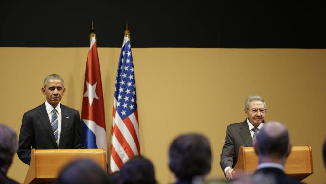 U.S. President Barack Obama, left, listens to Cuba's President Raul Castro, during a joint statement in Havana, Cuba, Monday, March 21, 2016. President Raul Castro called on President Obama to lift longstanding U.S. restrictions on Cuba, even as he and Obama pledged to move forward with normalizing relations between Cuba and its longtime Cold War-era foe. (AP Photo/Ramon Espinosa)