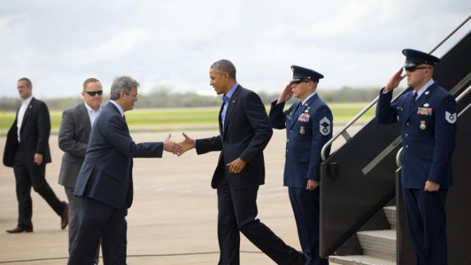 President Barack Obama is greeted by Austin, Texas Mayor Steve Adler on the tarmac upon his arrival on Air Force One, Friday, March 11, 2016, at Austin Bergstrom International Airport in Austin, Texas. Obama traveled to Austin, to speak at South by Southwest Festival (SXSW) and attend 2 Democratic National Committee fundraisers. (AP Photo/Pablo Martinez Monsivais)