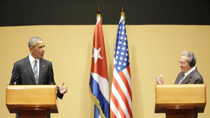 U.S. President Barack Obama, left, speaks next to Cuba's President Raul Castro, during a joint statement in Havana, Cuba, Monday, March 21, 2016. President Raul Castro called on President Obama to lift longstanding U.S. restrictions on Cuba, even as he and Obama pledged to move forward with normalizing relations between Cuba and its longtime Cold War-era foe. (AP Photo/Ramon Espinosa)