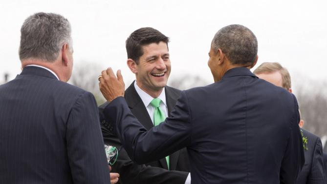 """President Barack Obama, center, shares a laugh with House Speaker Paul Ryan of Wis., after walking down the steps of the Capitol in Washington, with from Rep. Peter King, R-N.Y., left, and Irish Prime Minister Enda Kenny, right. after attending a """"Friends of Ireland"""" luncheon. (AP Photo/Pablo Martinez Monsivais)"""