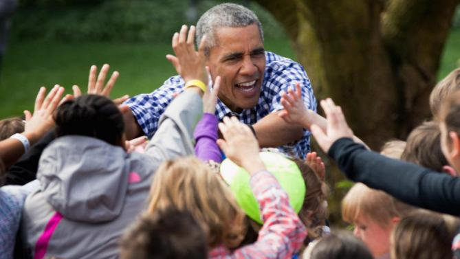 President Barack Obama greets children after reading to them during the White House Easter Egg Roll on the South lawn at the White House in Washington, Monday, March 28, 2016. Thousands of children gathered at the White House for the annual Easter Egg Roll. This year's event features  live music, sports courts, cooking stations, storytelling, and Easter egg rolling. (AP Photo/Andrew Harnik)