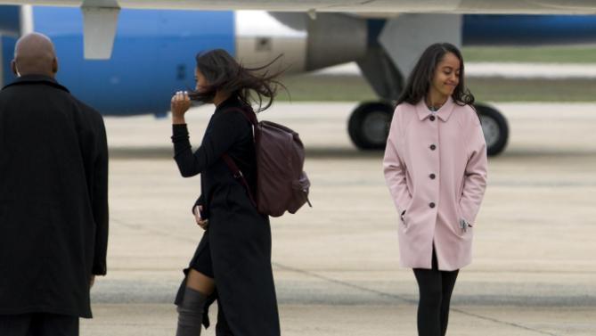 Sasha, left, and Malia Obama walk towards Air Force One upon the arrival to Andrews Air Force Base, before their departure, Sunday, March 20, 2016, en route to Havana, Cuba. President Obama and his family are traveling to Havana, Cuba, the first U.S. president to visit the island in nearly 90 years. ( AP Photo/Jose Luis Magana)