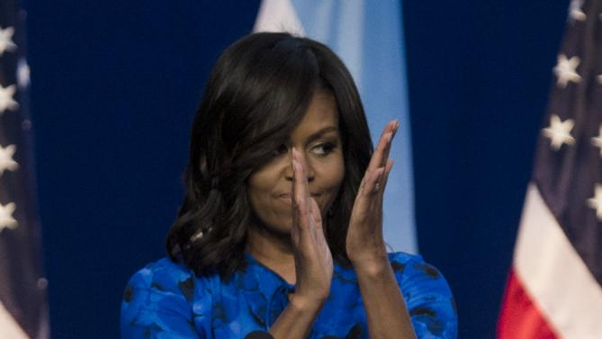 First lady Michelle Obama applauds during a meeting with high school students at the Centro Metropolitano de Diseño, in Buenos Aires, Argentina, Wednesday, March 23, 2016. The First Lady talked about the importance of completing their studies, as part of the Lets Girls Learn initiative. (AP Photo/Ivan Fernandez)