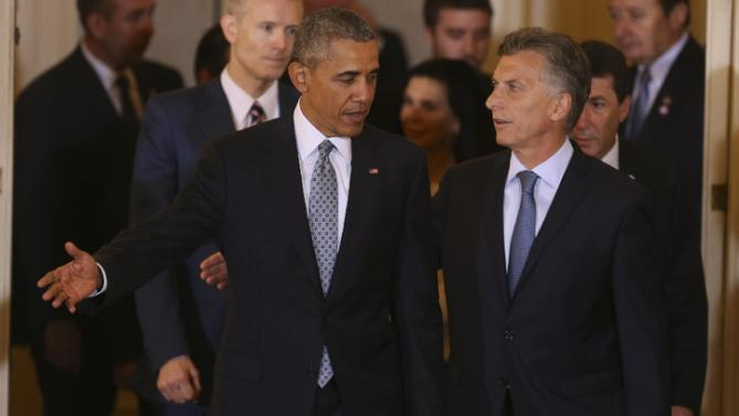 Argentina's President Mauricio Macri greets U.S. President Barack Obama at government house in Buenos Aires, Argentina, Wednesday, March 23, 2016. Obama is on a two day official visit to Argentina. (David Fernandez/Pool Photo via AP)