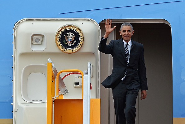 US President Barack Obama waves as he disembarks from Air Force One at the Tan Son Nhat airport in Ho Chi Minh City on May 24, 2016. Obama told communist Vietnam that basic human rights would not jeopardise its stability, in an impassioned appeal for the one-party state to abandon authoritarianism. / AFP / CHRISTOPHE ARCHAMBAULT (Photo credit should read CHRISTOPHE ARCHAMBAULT/AFP/Getty Images)