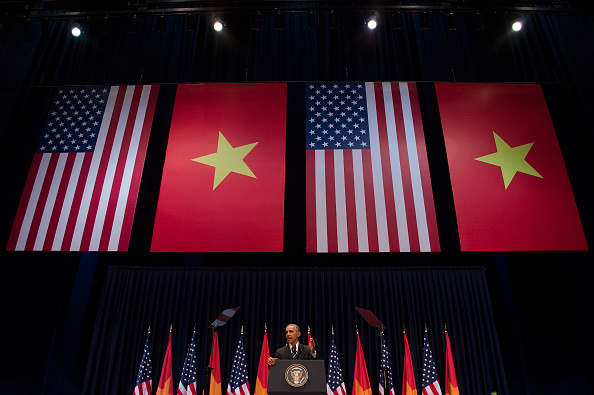 US President Barack Obama delivers remarks at the National Convention Center in Hanoi on May 24, 2016. Obama, currently on a visit to Vietnam, met with civil society leaders including some of the country's long-harassed critics on May 24. The visit is Obama's first to the country -- and the third by a sitting president since the end of the Vietnam War in 1975. / AFP / JIM WATSON (Photo credit should read JIM WATSON/AFP/Getty Images)