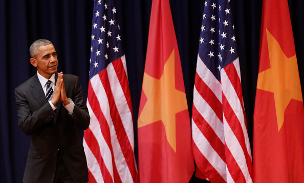 US President Barack Obama gestures after delivering a speech at the National Convention Center in Hanoi on May 24, 2016. Obama, currently on a visit to Vietnam, met with civil society leaders including some of the country's long-harassed critics on May 24. / AFP / POOL / KHAM (Photo credit should read KHAM/AFP/Getty Images)